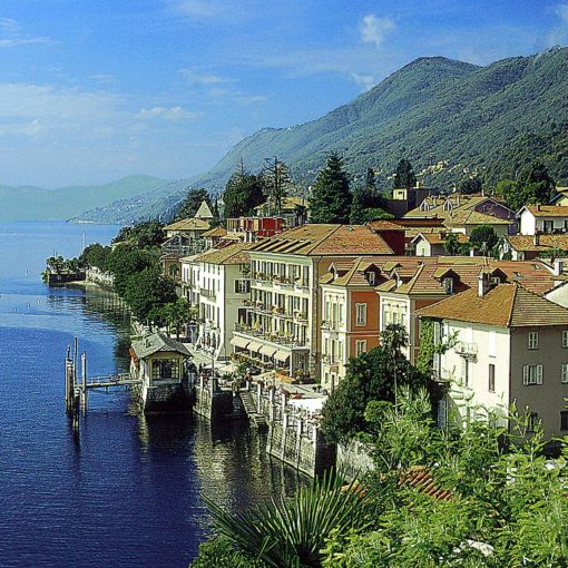 View of houses and mountains on the edge of a lake on the Cannero Riviera, Italian Lakes, Italy