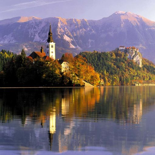 View of Otok and Bled Castle, from the southern shore of Lake Bled in Slovenia